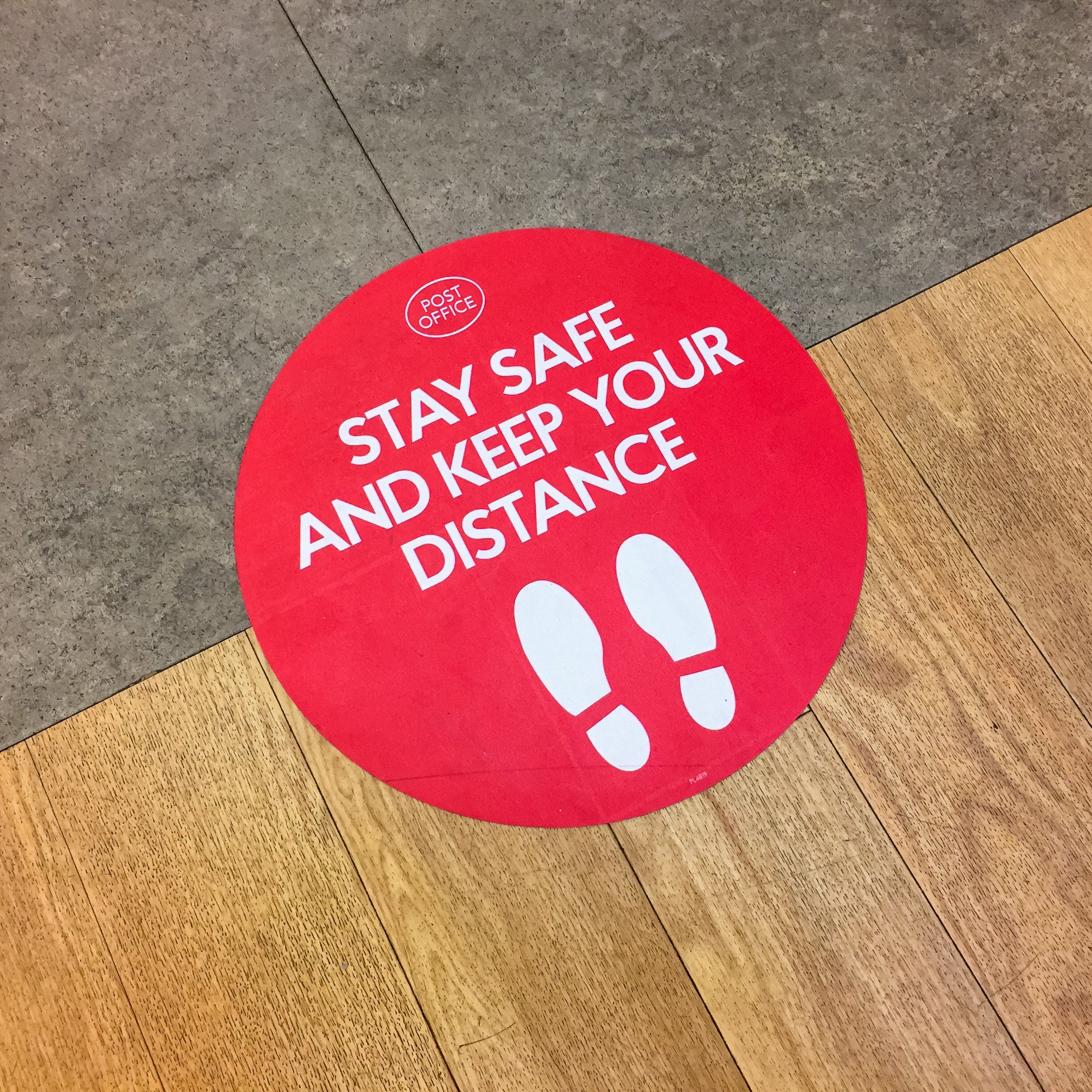 London, UK. May 11th 2020: Houndsditch post office. Customer floor sign, warning to stay safe and keep your distance. Lockdown, coronavirus outbreak, safety sticker, social distancing in a public area